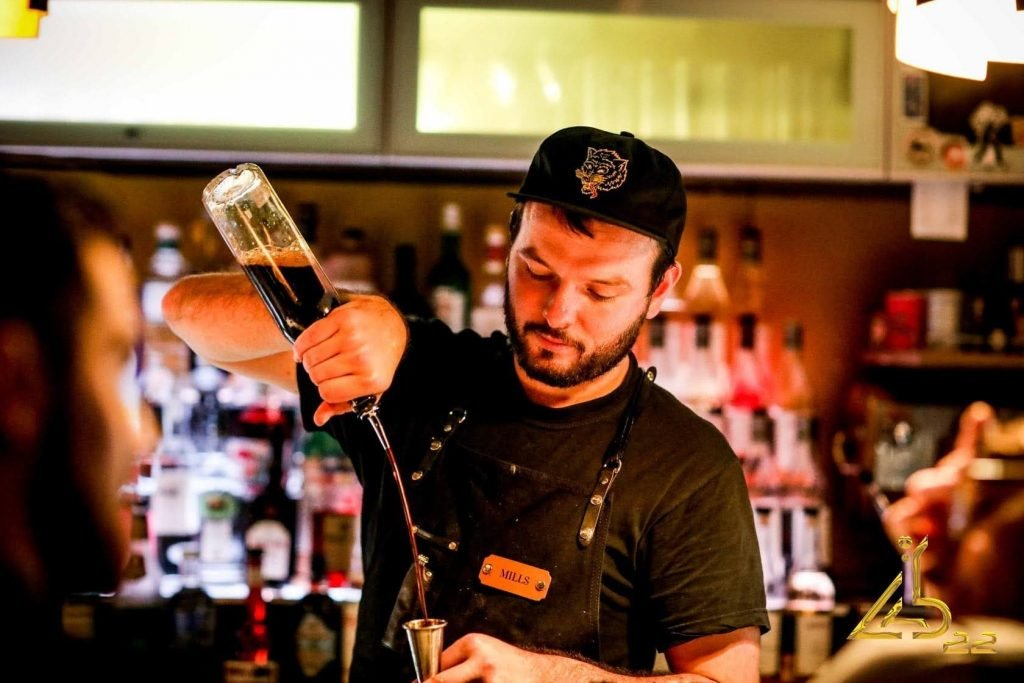 Alex Mills from Lab 22 in Cardiff pouring vodka