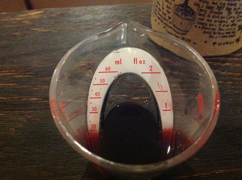 Master of Cocktails Blood and Sand measuring Professor Cornelius Ampleforth's Cherry Brandy