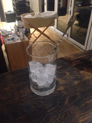 Master of Cocktails mixing glass with ice