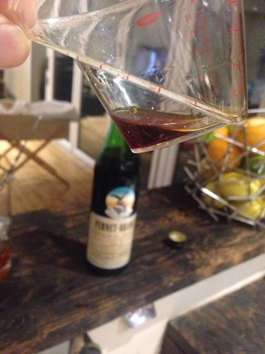 Master of Cocktails measuring Fernet Branca